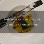 La Ricetta Gourmet: trancio di Ricciola arrostita al nero di Seppia con Asparagi, Fiori di Zucca e salsa allo Zafferano